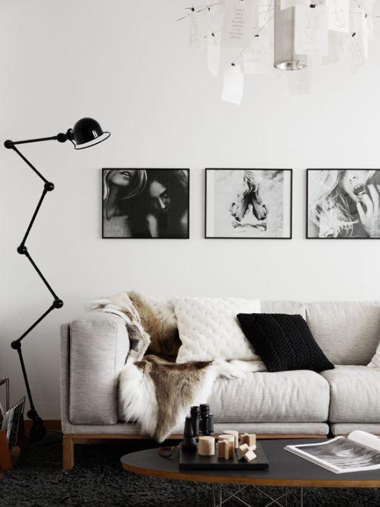 Séjour blanc et noir à la décoration scandinave