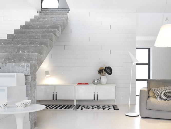 sejour-salon-contemporain-escalier-beton-enfilade-mur-lambris-blanc-design-gascogne-bois