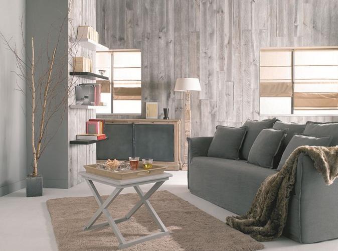 sejour-salon-gris-canape-lambris-mur-branche-buffet-beton-fourrure-tapis-beige